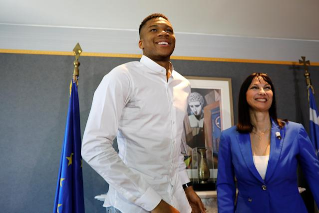 NBA All-Star and Milwaukee Bucks forward Giannis Antetokounmpo and Tourism minister Elena Kountoura arrive for a press conference presenting the new Greek Tourism ministry ad campaign in Athens, Greece, June 29, 2018. REUTERS/Alkis Konstantinidis