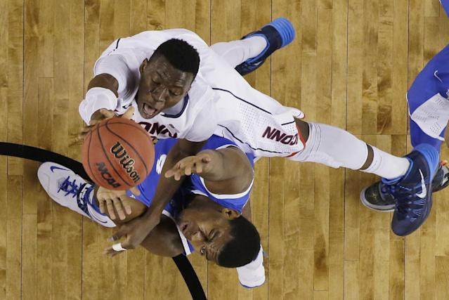 Connecticut center Amida Brimah, top, shoots over Kentucky center Dakari Johnson during the first half of the NCAA Final Four tournament college basketball championship game Monday, April 7, 2014, in Arlington, Texas. (AP Photo/David J. Phillip)