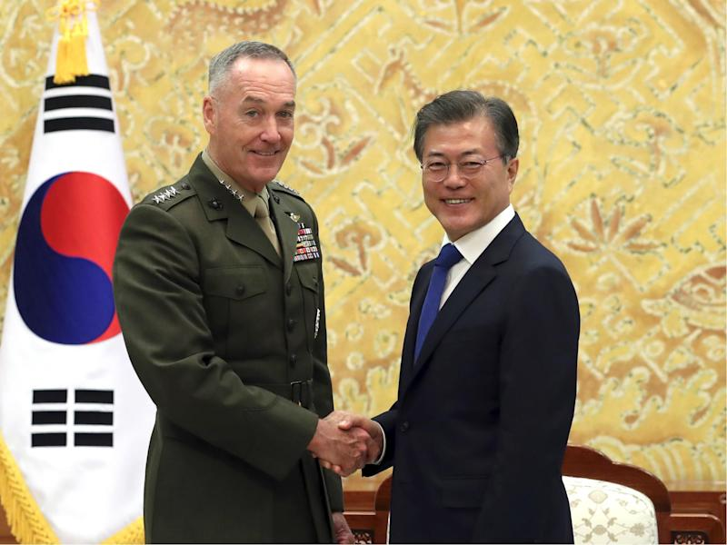 South Korean President Moon Jae-in poses with US Joint Chiefs Chairman General Joseph Dunford for a photo during a meeting at the presidential Blue House in Seoul, South Korea: Bae Jae-man/Yonhap via AP