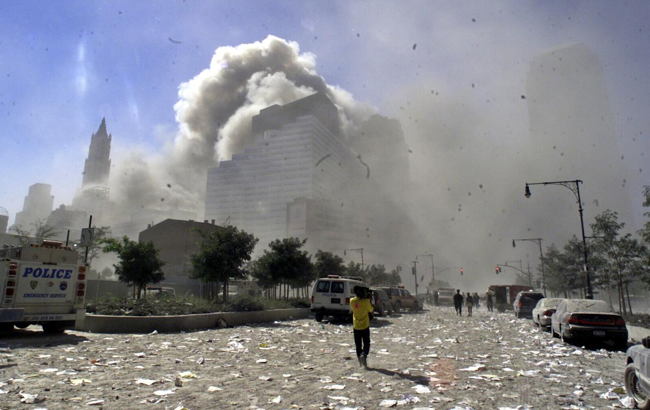 A street in New York's lower Manhattan area is littered with debris after the collapse of the twin towers of the World Trade Center following terrorist attacks, Sept. 11, 2001. (AP Photo/Richard Drew)