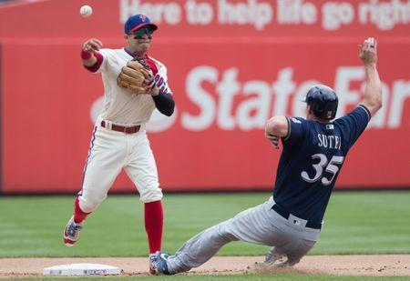 Jun 9, 2018; Philadelphia, PA, USA; Philadelphia Phillies second baseman Cesar Hernandez (16) tags out Milwaukee Brewers relief pitcher Brent Suter (35) on a fielders choice during the fifth inning at Citizens Bank Park. Mandatory Credit: Bill Streicher-USA TODAY Sports