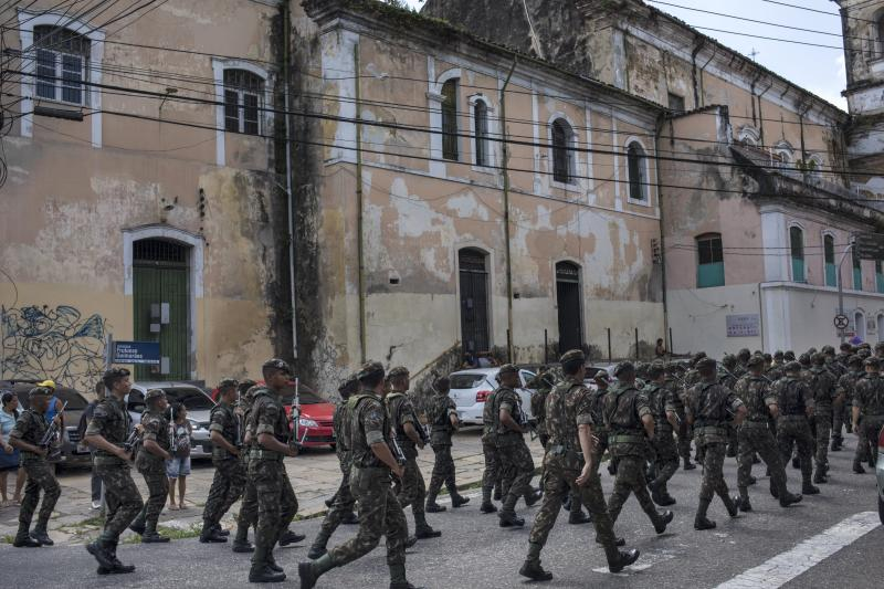 In this Sept. 7, 2019 photo, military police parade near the Ver-o-Peso riverside market in Belém, Brazil. The city is the capital and largest city of the state of Pará and is the gateway to the Amazon River with a busy port, airport, and bus/coach station. (AP Photo/Rodrigo Abd)