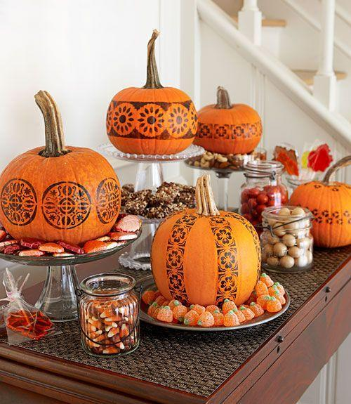 """<p>A candy buffet gets some Halloween spirit, thanks to no-carve pumpkins. To create the patterns, tape on multiple store-bought stencils (simple graphic designs work best), brush over them with black acrylic paint and you're done.</p><p><a class=""""link rapid-noclick-resp"""" href=""""https://www.amazon.com/CrafTreat-Flourish-Background-Stencil-x6/dp/B0756F1TQK/ref=sr_1_1_sspa?tag=syn-yahoo-20&ascsubtag=%5Bartid%7C10055.g.1714%5Bsrc%7Cyahoo-us"""" rel=""""nofollow noopener"""" target=""""_blank"""" data-ylk=""""slk:SHOP STENCILS"""">SHOP STENCILS</a><br></p><p><em><a href=""""https://www.goodhousekeeping.com/holidays/halloween-ideas/a23920/stamp-pumpkins/"""" rel=""""nofollow noopener"""" target=""""_blank"""" data-ylk=""""slk:Get the tutorial »"""" class=""""link rapid-noclick-resp"""">Get the tutorial »</a></em></p>"""