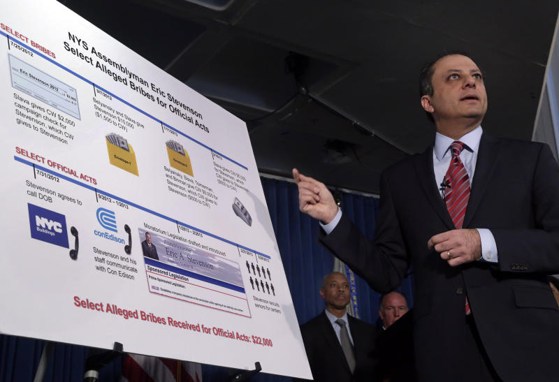 U.S. Attorney Preet Bharara gestures to a chart during a news conference in New York, Thursday, April 4, 2013. New York state Assemblyman Eric Stevenson, a Democrat, was arrested in a bribery investigation that also led another state assemblyman charged with crimes to cooperate with the understanding that he would resign his position with the arrests of Stevenson and four other defendants.(AP Photo/Richard Drew)