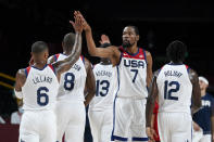 United States's Kevin Durant (7) celebrates with teammate Damian Lillard (6) during a men's basketball preliminary round game against the Czech Republic at the 2020 Summer Olympics, Saturday, July 31, 2021, in Saitama, Japan. (AP Photo/Charlie Neibergall)