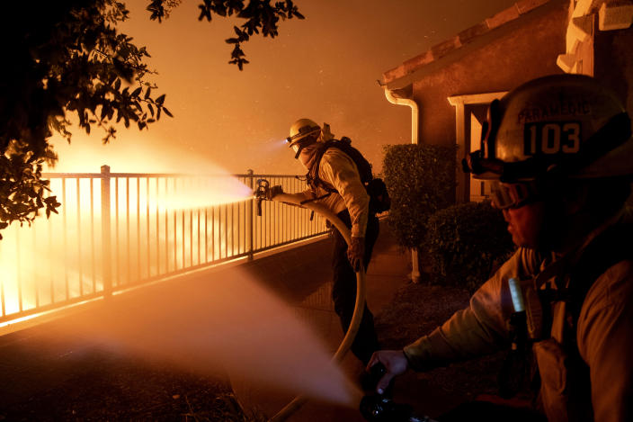 In this Thursday, Oct. 10, 2019 photo, Los Angeles City firefighters battle the Saddleridge fire near homes in Sylmar, Calif. (Photo: Michael Owen Baker/AP)