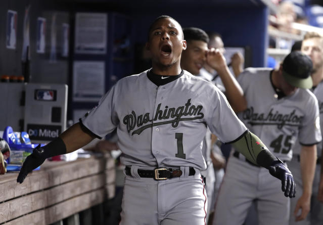 Washington Nationals' Wilmer Difo reacts after scoring on a solo home run during the eighth inning of a baseball game against the Miami Marlins, Saturday, May 26, 2018, in Miami. (AP Photo/Lynne Sladky)