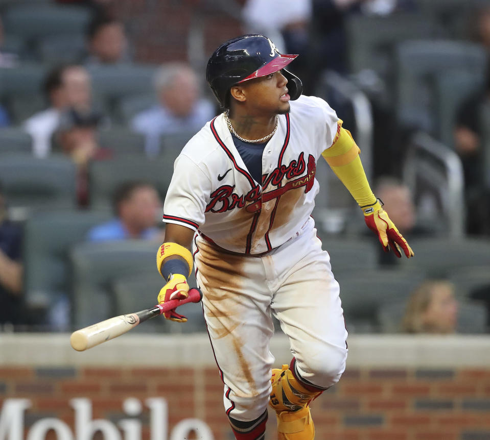 Atlanta Braves outfielder Ronald Acuna hits a solo home run against the Toronto Blue Jays during the third inning of a baseball game on Tuesday, May 11, 2021, in Atlanta. (Curtis Compton/Atlanta Journal-Constitution via AP)