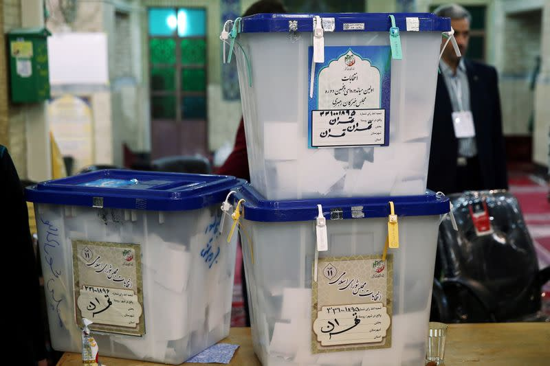 Full ballot boxes are pictured after the parliamentary election voting time ended in Tehran