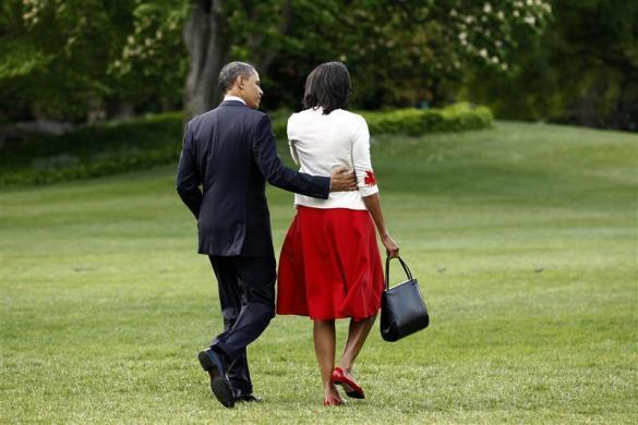 Barack Obama and first lady Michelle walk toward Marine One as they depart the White House in Washington April 27, 2012.