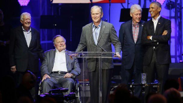 PHOTO: Former President George W. Bush, center, speaks as fellow former Presidents from right, Barack Obama, Bill Clinton, George H.W. Bush and Jimmy Carter look on during a hurricanes relief concert in College Station, Texas, Oct. 21, 2017. (LM Otero/AP)