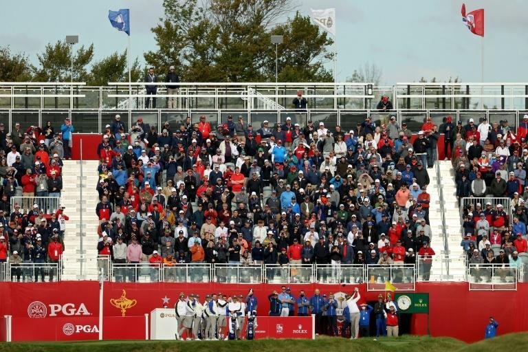 Spectators at the first tee for the Ryder Cup are expected to provide an electric atmosphere for Friday's start of the 43rd edition of the team golf showdown between US and European squads (AFP/Patrick Smith)