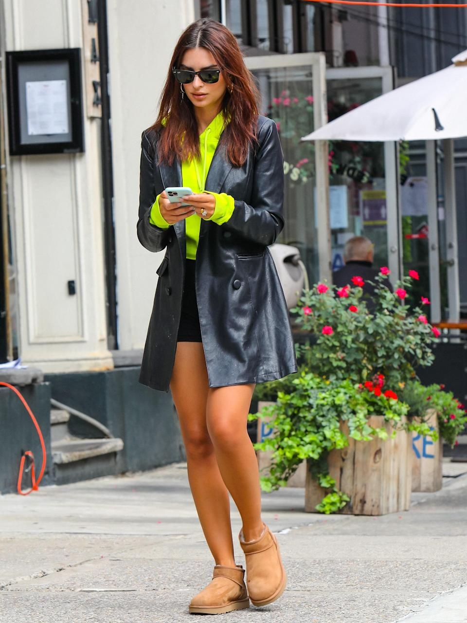Emily Ratajkowski in the Ultra Minis and a leather trench
