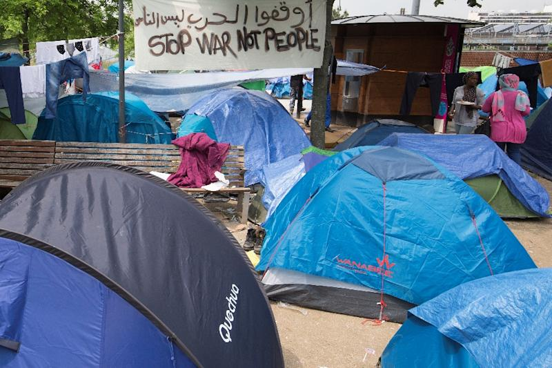 Refugees and migrants are pictured in a makeshift camp in Paris on May 27, 2016 (AFP Photo/Joel Saget)