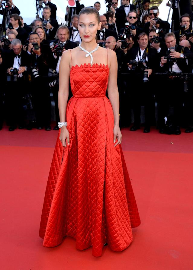 <p>Sure, Bella Hadid's red gown is sweet, but it's her diamond Bulgari necklace that really pops. (Photo by Anthony Harvey/FilmMagic) </p>