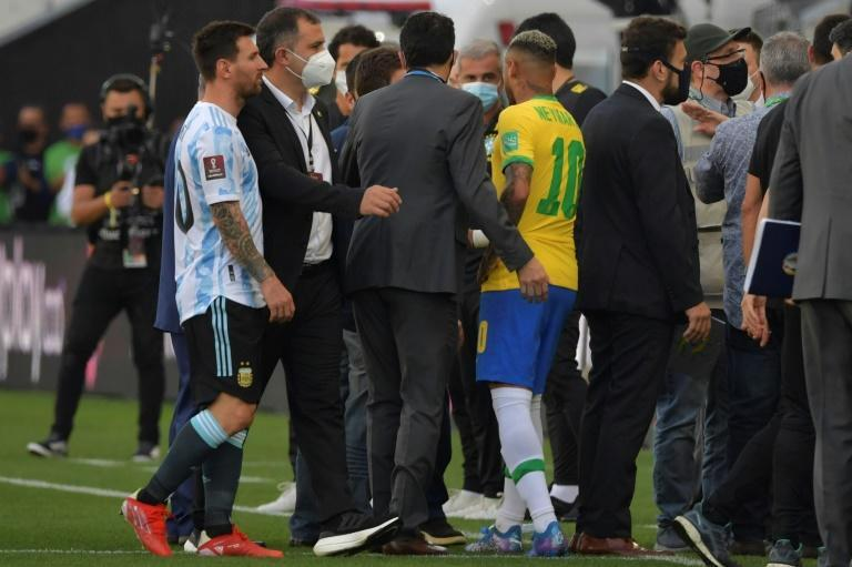 Argentina's Lionel Messi (L) and Brazil's Neymar are seen after the two teams' World Cup qualifier was halted by Brazilian health officials in Sao Paulo on Sunday (AFP/NELSON ALMEIDA)