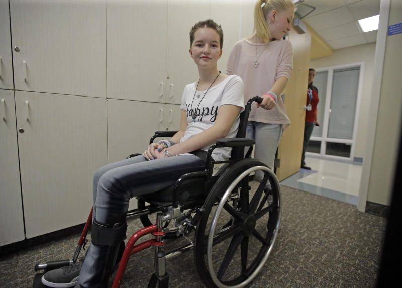 FILE - In this April 20, 2017, file photo, Deserae Turner, a Utah teenage girl who survived being shot in the head by two boys, is wheeled from a news conference after speaking with reporters at Primary Children's Hospital in Salt Lake City. Turner, a Utah high school student who survived a gunshot wound to the head was named homecoming queen by her classmates. Turner was found in a ditch after being shot in the back of the head and left for dead by two classmates in February 2017. (AP Photo/Rick Bowmer, File)
