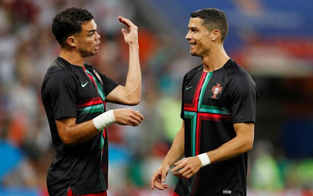 Soccer Football - World Cup - Group B - Iran vs Portugal - Mordovia Arena, Saransk, Russia - June 25, 2018 Portugal's Cristiano Ronaldo with Pepe during the warm up before the match REUTERS/Matthew Childs