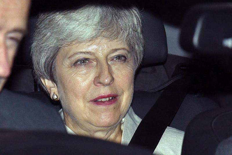 Britain's former prime minister Theresa May is driven away from the Houses of Parliament after attending an emergency debate on a no-deal Brexit in London on September 3, 2019. - Prime Minister Boris Johnson suffered a major parliamentary defeat over his Brexit strategy on Tuesday, which could delay Britain's exit from the European Union next month and force an early election. (Photo by Oli SCARFF / AFP) (Photo credit should read OLI SCARFF/AFP/Getty Images)