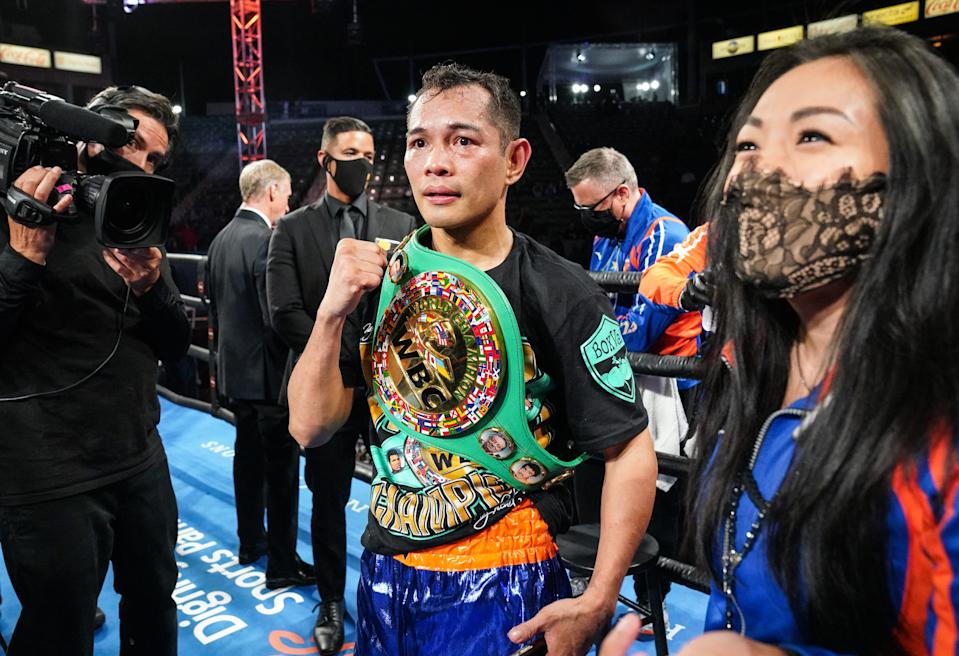 Nonito Donaire and his wife/head trainer, Rachel, celebrate after his fourth-round KO win over Nordine Oubaali to reclaim the WBC bantamweight title on May 29, 2021 in Carson, California. (Sean Michael Ham/TGB Promotions)