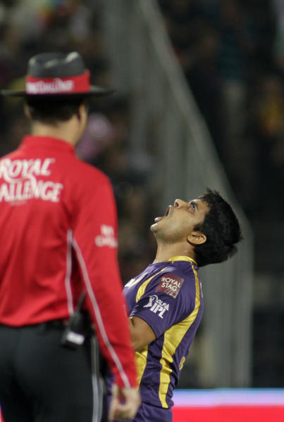 Kolkata Knight Riders' Rajat Bhatia celebrates Delhi Daredevils Naman Ojha's wicket during their Indian Premier League (IPL) cricket playoff match in Pune, India, Tuesday, May 22, 2012. (AP Photo/Rajanish Kakade)