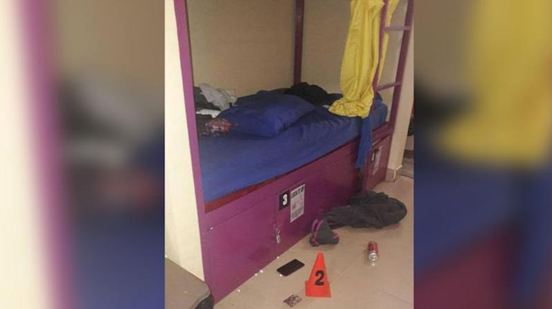 The bunk beds where the backpackers were found dead, with pills scattered on the ground. Source: Department of Immigration