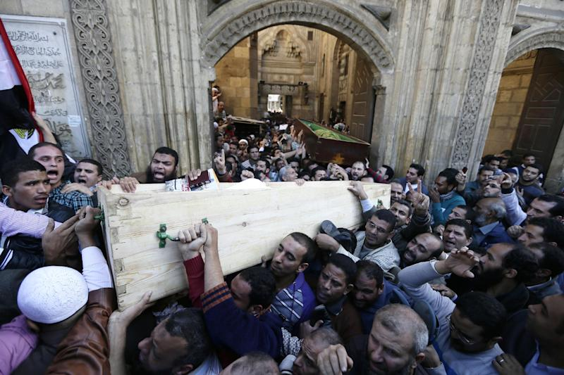 "Muslim Brotherhood and Egyptian President Morsi supporters carry two bodies who were killed during Wednesday's clashes during their funeral outside Al Azhar mosque, the highest Islamic Sunni institution, Friday, Dec. 7, 2012. During the funeral, thousands Islamist mourners chanted, ""with blood and soul, we redeem Islam,"" pumping their fists in the air. ""Egypt is Islamic, it will not be secular, it will not be liberal,"" they chanted as they walked in a funeral procession that filled streets around Al-Azhar mosque. Thousands of Egyptians took to the streets after Friday midday prayers in rival rallies and marches across Cairo, as the standoff deepened over what opponents call the Islamist president's power grab, raising the specter of more violence. (AP Photo/Hassan Ammar)"