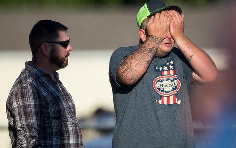 A man wipes his eyes after a deadly shooting at the First Baptist Church in Sutherland Springs - Credit: Nick Wagner/Austin American-Statesman via AP