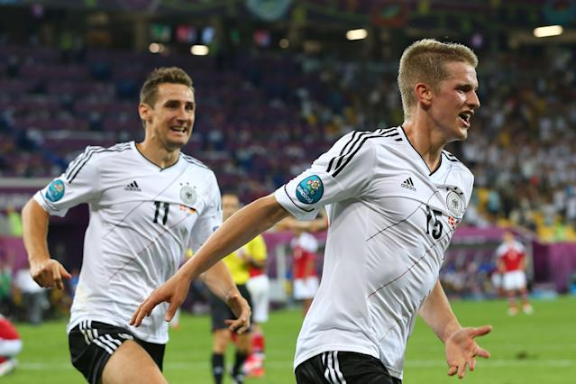 L'VIV, UKRAINE - JUNE 17: Lars Bender of Germany celebrates scoring their second goal with Miroslav Klose of Germany during the UEFA EURO 2012 group B match between Denmark and Germany at Arena Lviv on June 17, 2012 in L'viv, Ukraine. (Photo by Martin Rose/Getty Images)