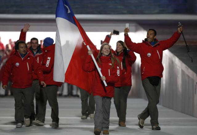 Chile's flag-bearer Dominique Ohaco leads her country's contingent during the opening ceremony of the 2014 Sochi Winter Olympics, February 7, 2014. REUTERS/Phil Noble (RUSSIA - Tags: OLYMPICS SPORT)