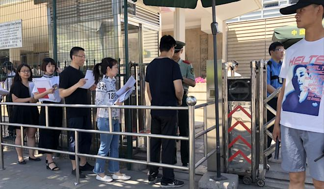Chinese queue up for visa interviews outside the US embassy in Beijing. Academics in sensitive scientific fields have come under increased scrutiny. Photo: Simon Song