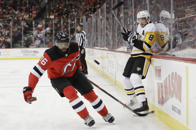 Pittsburgh Penguins' Brian Dumoulin (8) passes the puck away from New Jersey Devils' P.K. Subban (76) during the first period of an NHL hockey game Friday, Nov. 15, 2019, in Newark, N.J. (AP Photo/Frank Franklin II)