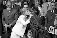 <p>Princess Diana greets her sister-in-law, the Duchess of York, at the royal box during Wimbledon. </p>