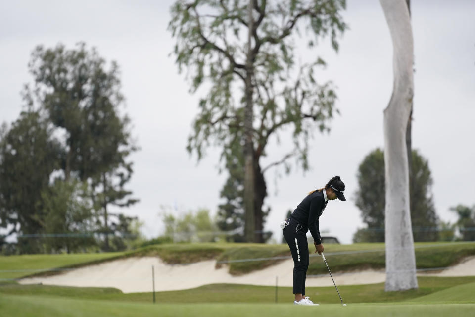 Patty Tavatanakit putts on the 10th green during the second round of the LPGA's Hugel-Air Premia LA Open golf tournament at Wilshire Country Club Thursday, April 22, 2021, in Los Angeles. (AP Photo/Ashley Landis)
