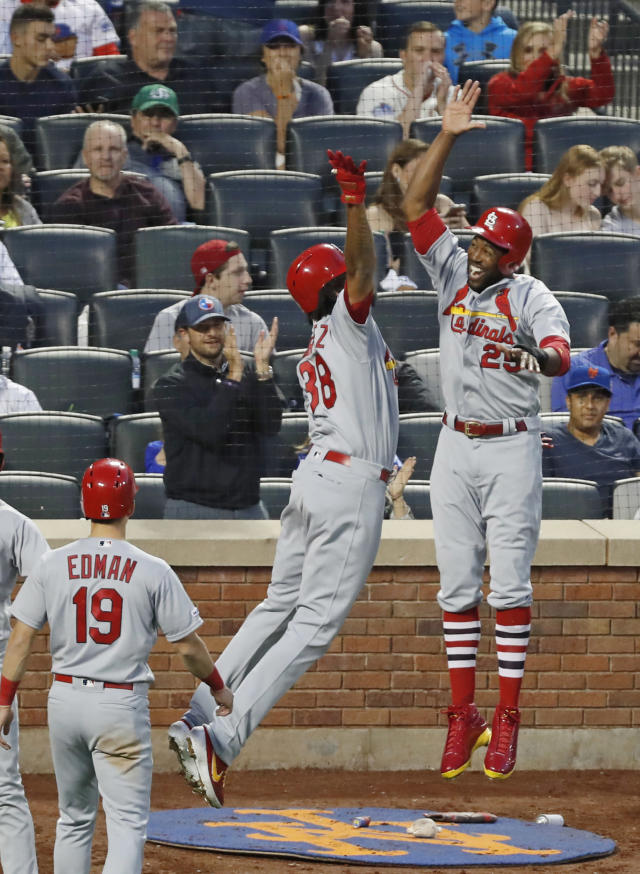 St. Louis Cardinals' Jose Martinez (38) celebrates with Cardinals' Dexter Fowler (25) after Fowler and Tommy Edman (19) scored on Martinez's home run in fifth inning of the team's baseball game against the New York Mets, Friday, June 14, 2019, in New York. (AP Photo/Kathy Willens)