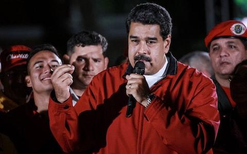 Venezuelan President Nicolas Maduro (C) celebrates election results after a national vote on his proposed Constituent Assembly at Plaza Bolivar in Caracas, Venezuela, 31 July 2017 - Credit: EPA