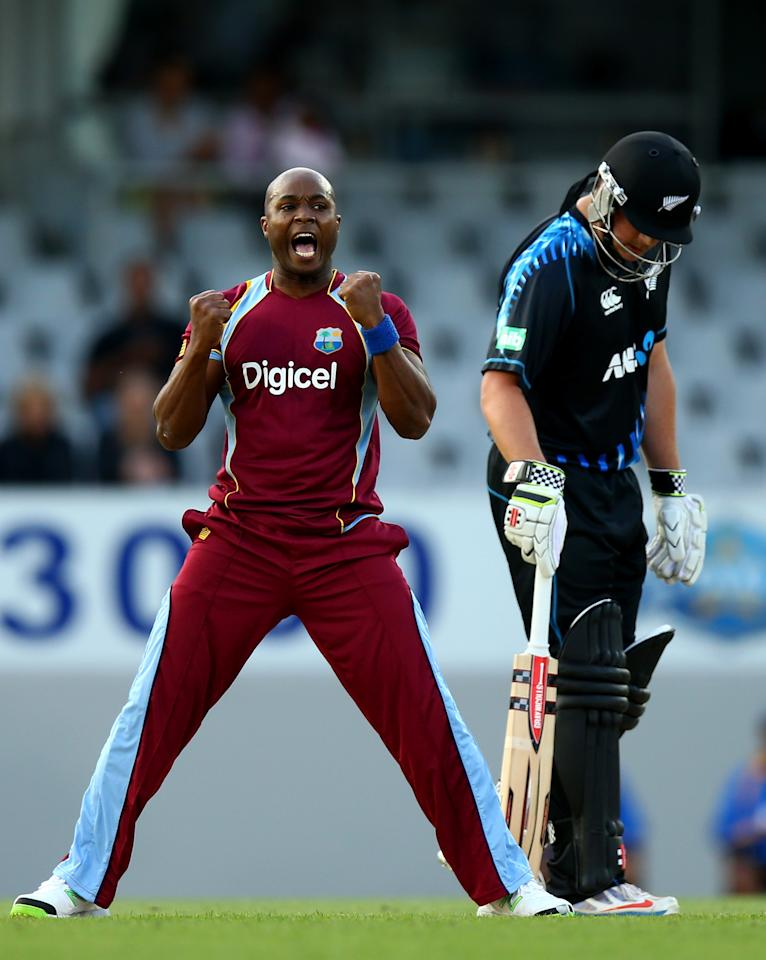 AUCKLAND, NEW ZEALAND - JANUARY 11:  Tino Best of the West Indies celebrates his wicket of Martin Guptill of New Zealand during the first T20 between New Zealand and the West Indies at Eden Park on January 11, 2014 in Auckland, New Zealand.  (Photo by Phil Walter/Getty Images)