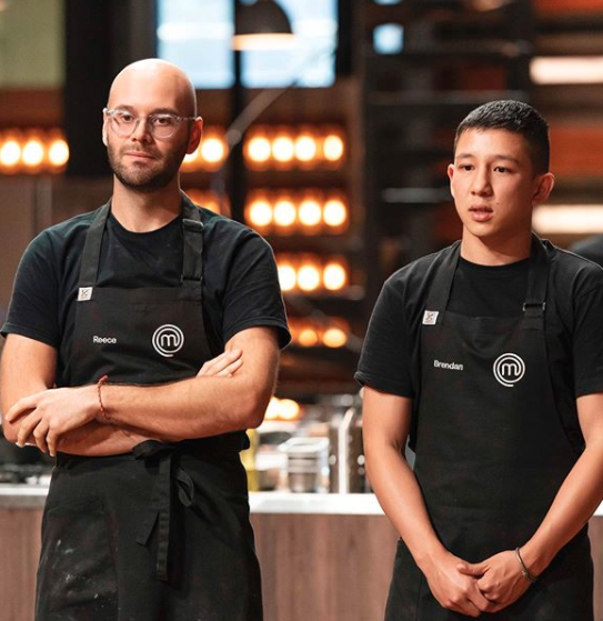 MasterChef's Brendan and Reece in black aprons