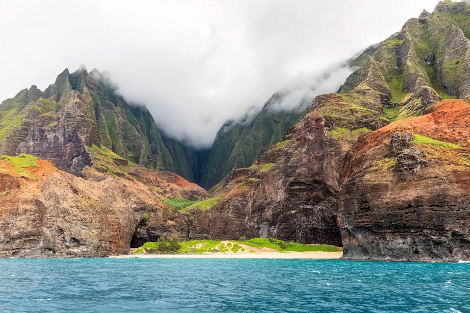 "<p><strong>Best thing to do in Hawaii:</strong> Take a helicopter tour of Kauai </p> <p>Kauai might be home to some of Hawaii's <a href=""https://www.cntraveler.com/galleries/2015-01-05/hawaii-best-hidden-beaches?mbid=synd_yahoo_rss"" rel=""nofollow noopener"" target=""_blank"" data-ylk=""slk:best hidden beaches"" class=""link rapid-noclick-resp"">best hidden beaches</a> and tropical rainforests, but a whopping 70 percent of the island is inaccessible by land. The best way to appreciate the breadth and beauty of the island is via helicopter (arrange a ride with tour companies like <a href=""https://www.bluehawaiian.com/kauai/tours/kauai-eco-adventure"" rel=""nofollow noopener"" target=""_blank"" data-ylk=""slk:Blue Hawaiian"" class=""link rapid-noclick-resp"">Blue Hawaiian</a> and <a href=""https://www.sunshinehelicopters.com/"" rel=""nofollow noopener"" target=""_blank"" data-ylk=""slk:Sunshine Helicopters"" class=""link rapid-noclick-resp"">Sunshine Helicopters</a>). Only by air can you truly appreciate the emerald valleys, jagged cliffs, and cascading waterfalls that cover the island. For truly epic views, go the Na Pali Coast route, and peer down at the impossibly deep chasms of Waimea Canyon.</p>"