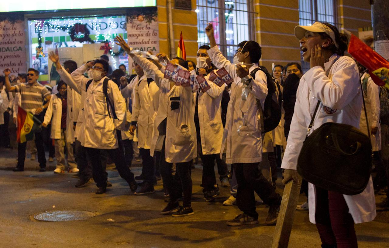 Healthcare employees shout slogans during a protest against Bolivia's government policy regarding healthcare system, in La Paz, Bolivia, December 15, 2017. Picture taken December 15, 2017. REUTERS/Luis Salazar