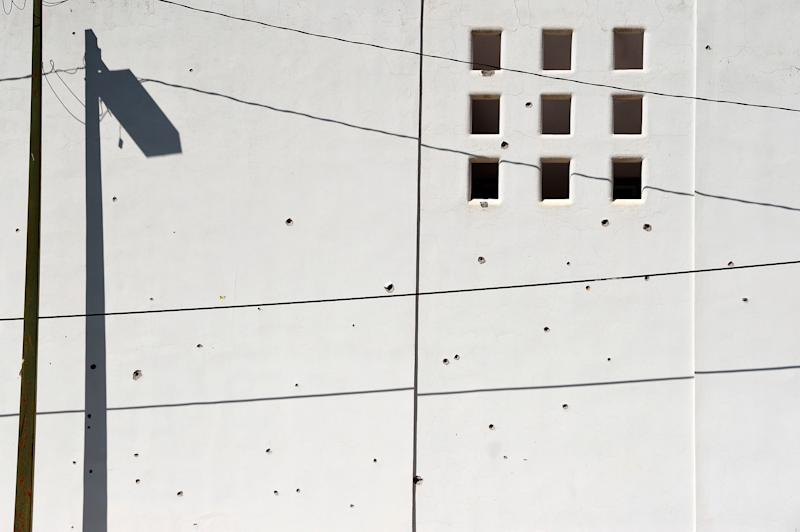 A wall is pockmarked with bullet holes in Culiacan on Oct. 18. | Alfredo Estrella—AFP/Getty Images