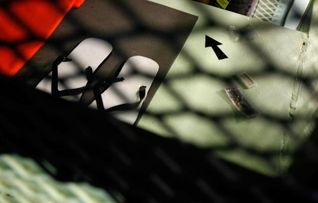 """GUANTANAMO BAY, CUBA - OCTOBER 2: (IMAGE REVIEWED BY U.S. MILITARY PRIOR TO TRANSMISSION) A small black arrow indicating the direction of Mecca is painted on a metal shelf inside a cell at Camp 1 in the detention facility at the U.S. Naval Station October 2, 2007 in Guantanamo Bay, Cuba. About 340 """"unlawful enemy combatants"""" captured since the September 11, 2001 attacks on the United States continue to be held at the facility. (Photo by Chip Somodevilla/Getty Images)"""
