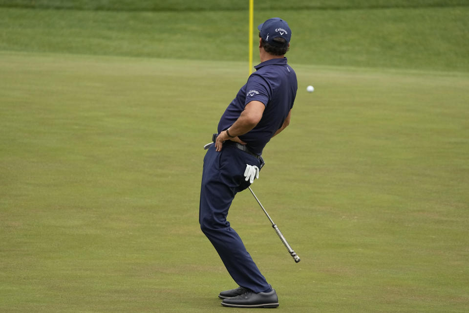 Phil Mickelson reacts to a missed birdie putt on the 16th green during the third round of the Masters golf tournament on Saturday, April 10, 2021, in Augusta, Ga. (AP Photo/Charlie Riedel)