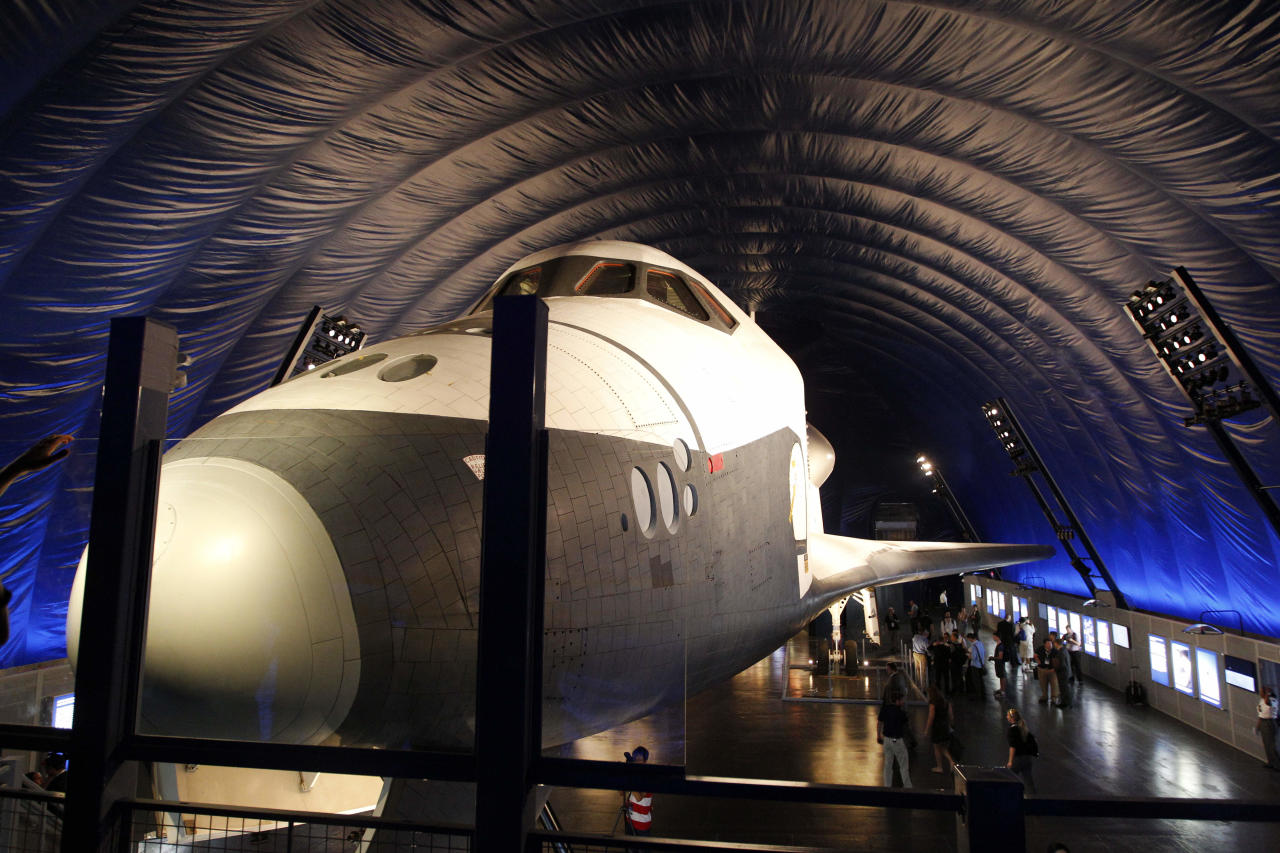 The Space Shuttle Enterprise sits on display at the Sea, Air and Space Museum's Space Shuttle Pavilion Wednesday, July 18, 2012, in New York. The Pavilion will be open to the public Thursday, July 19, 2012.(AP Photo/Frank Franklin II)
