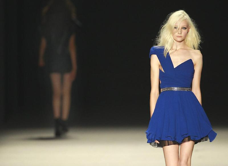 Models wear creations by Born French fashion designer Hedi Slimane for St Laurent ready-to-wear Spring/Summer 2014 fashion collection, presented in Paris, Monday, Sept.30, 2013. (AP Photo/Jacques Brinon)