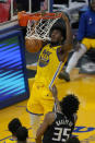 Golden State Warriors center James Wiseman (33) dunks over Sacramento Kings forward Marvin Bagley III (35) during the first half of an NBA basketball game in San Francisco, Monday, Jan. 4, 2021. (AP Photo/Jeff Chiu)