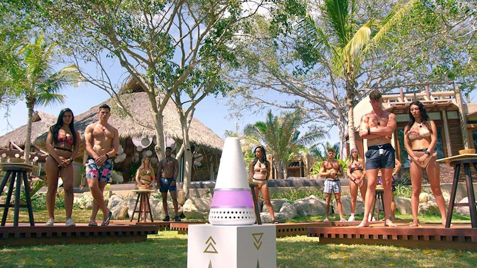 <p>In case you've been living under a rock, Netflix has a new reality dating show to obsess over. It's called <em>Too Hot To Handle</em>. Smoking hot singles are sent to a remote villa to get it on for a month in the sun…or so they think. A few wrenches are thrown into their plans as a purple and white talking cone dishes out rules that ruin their summer. What exactly are the rules of <em>Too Hot To Handle</em>? Let's begin with the basics.</p>