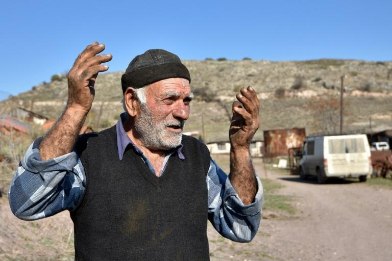 Pomegranate grower Zhorik Grigoryan, 73, nearly lost his pomegranate field in the fighting