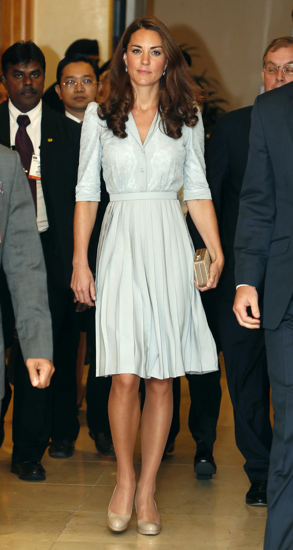 <p>For her arrival in Kuala Lumpur, Kate donned a duck egg blue dress by Jenny Packham along with nude L.K. Bennett pumps.</p><p><i>[Photo: PA]</i></p>
