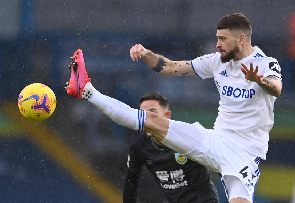 Mateusz Klich challenges for the ball in midfield (Pool via REUTERS)
